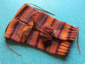 Two socks being knitted at the same time
